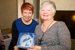 Lynda Avis, BCAHA president, presents Helen with a gift of thanks and appreciation.